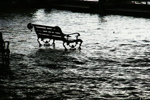 Flooded street with bench