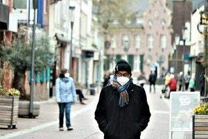Man in mask on street